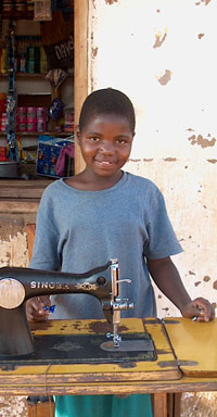 African Child with Singer Sewing Machine, Malawi, Around 2000