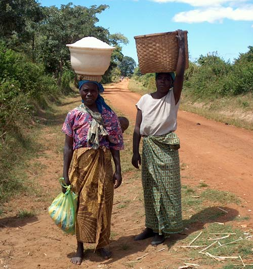 African Women Carrying Children and Loads Along Road, Malawi, around 2000