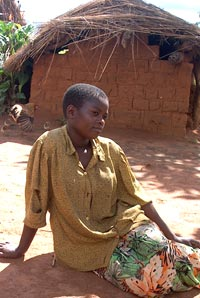 African Woman in Courtyard by House, Malawi, Around 2000