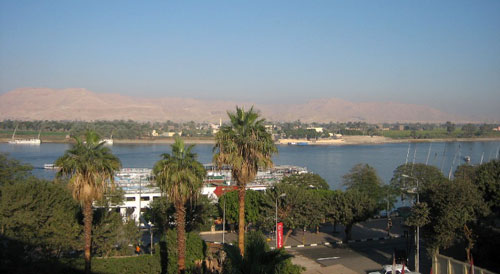 The Nile River as it flows through Luxor, located in Upper Egypt, with the Valley of the Kings in the background, 2007