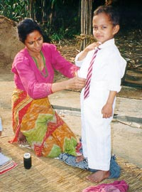 Mother Preparing Child for School, Nepal, Around 2000