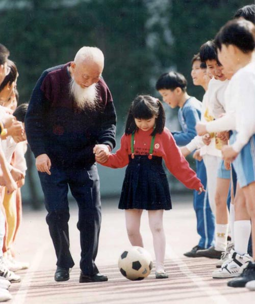 Elderly Man and Girl Playing Soccer, Taiwan, 1980s