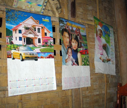 these calendars are the only decoration for the walls of a house in a remote rural village